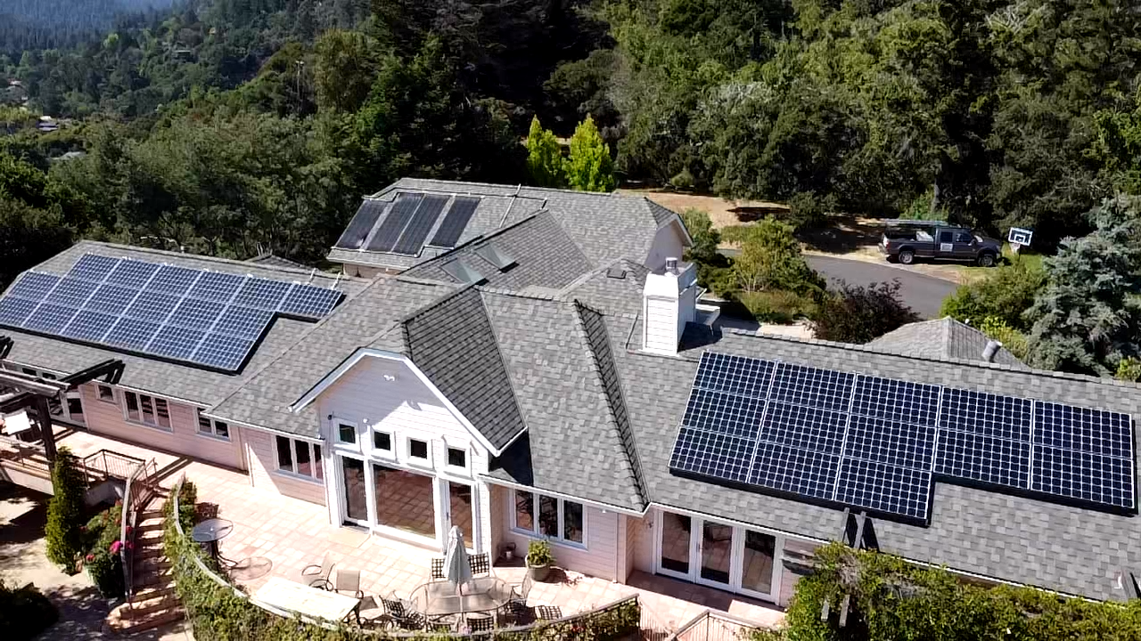 Asphalt shingle roof install in Santa Cruz California installed with solar panels completed by Redwood Roofs