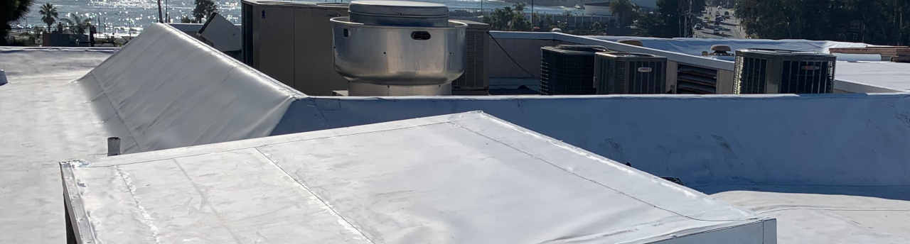 Featured commercial flat roof installed by top roofing company in Santa Cruz