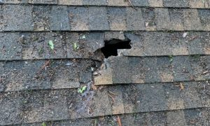A puncture in composite shingle roof causing a leak that must be repaired by a roofing company in Aptos CA.