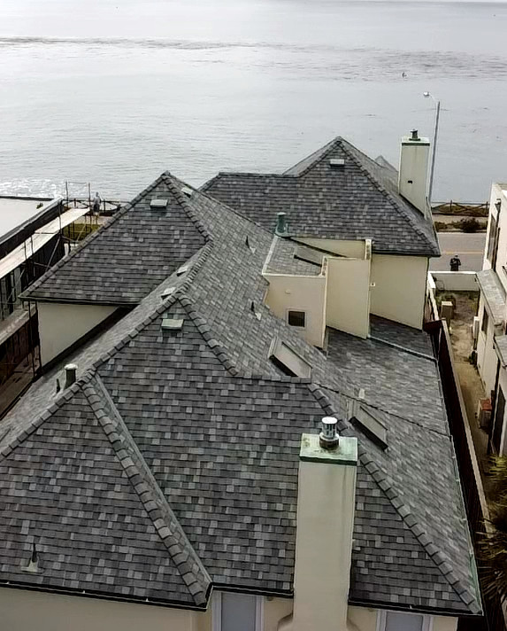 Multi pitch asphalt shingle roof installed near the coast by local roofing company in Santa Cruz CA