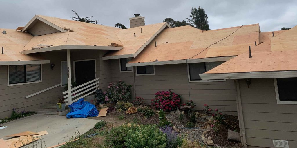 Reroof in progress on a home in Capitola, CA by top roofing contractor, Redwood Roofing and Repair